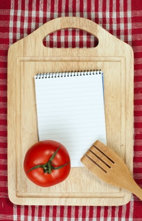 Notebook to write recipes and vegetables around it photo