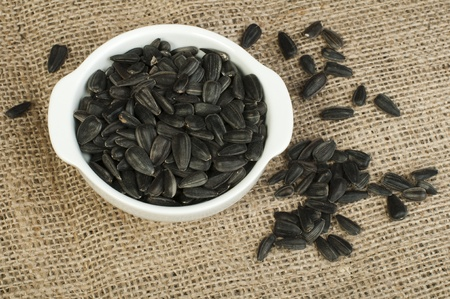 Sunflower seed on burlap brown background Stock Photo - 17268078