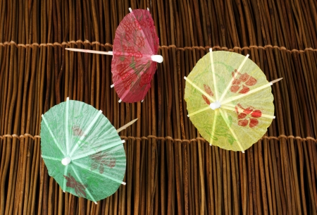 Colorful cocktail umbrellas on wooden base. Close up  Stock Photo - 17515995