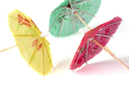Colorful cocktail umbrellas white isolated. Close up Stock Photo - 17515490