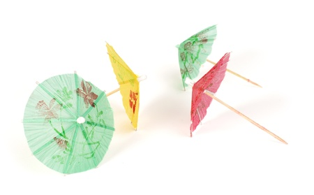 Colorful cocktail umbrellas white isolated. Close up Stock Photo - 17515389