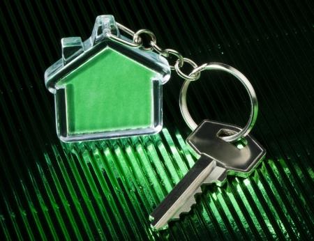 keychain: Keychain figure of house and key close up
