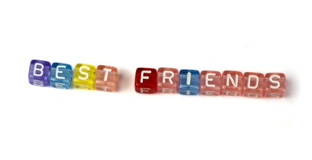 best friends: Phrase best friends on multicolored wooden cubes white isolated