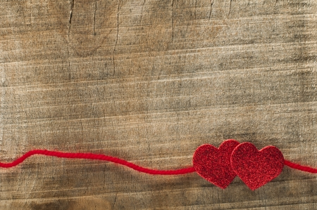 valentines day: Red ribbon tape and hearts on wooden background.