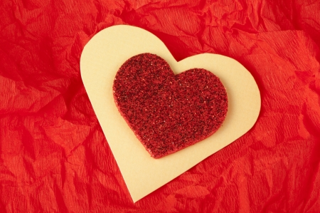 wrinkled paper: Red heart brocade shape on a wrinkled paper Stock Photo