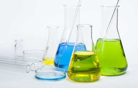 analytical chemistry: Laboratory glassware equipment. Laboratory beakers filled with colored liquid substances