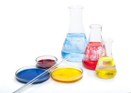 Laboratory equipment and color chemicals on white background Stock Photo