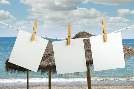 instant message: Note papers hooked on a rope. Beach background