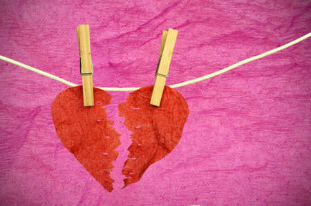 heartbreak issues: Red paper Heart divided into two parts Stock Photo
