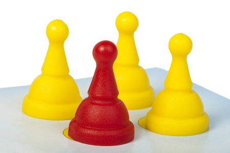 Red and yellow game pawns white isolated. Lideship conception Stock Photo - 18232350
