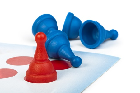 Red and blue game pawns white isolated. Lideship conception Stock Photo - 18232343