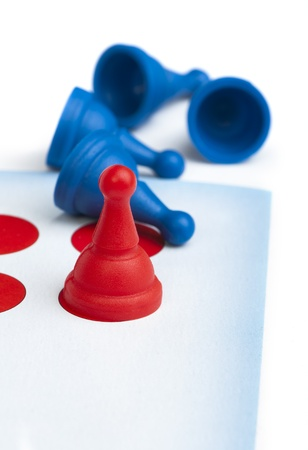 Red and blue game pawns white isolated. Lideship conception Stock Photo - 18232383