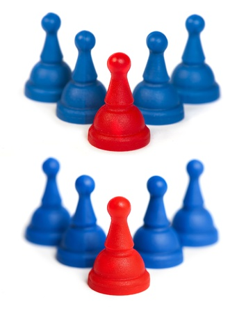 Red and blue game pawns white isolated. Lideship conception Stock Photo - 18236438