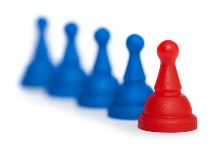 Red and blue game pawns white isolated. Lideship conception Stock Photo - 18232357