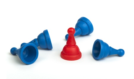 Red and blue game pawns white isolated. Lideship conception Stock Photo - 18232225