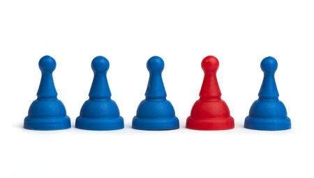 Red and blue game pawns white isolated. Lideship conception Stock Photo - 18232202