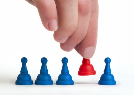 Red and blue game pawns white isolated. Lideship conception Stock Photo - 18232270