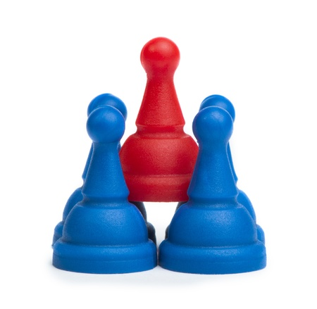 Red and blue game pawns white isolated. Lideship conception Stock Photo - 18232265