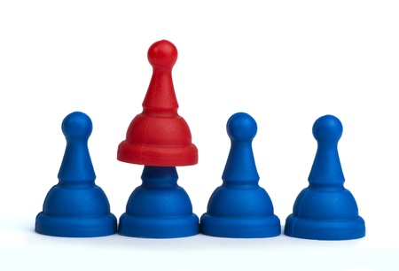 Red and blue game pawns white isolated. Lideship conception Stock Photo - 18232233