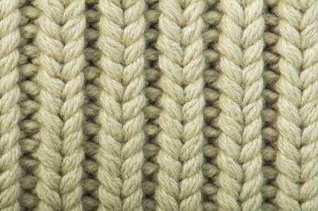 Oude gebreide trui achtergrond. Beige kleur. Studio shot Stockfoto