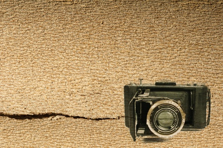 Old vintage camera woodenl background Stock Photo - 18236519