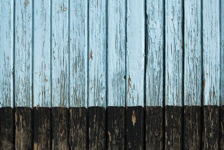 Old cracked paint on old boards. Wooden wall photo