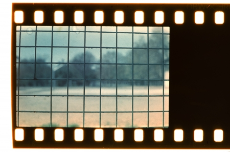 Vintage grid. Real film strip. Black color photo