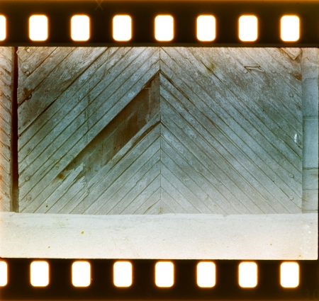 Vintage door and wall on film strip. Real photographic film photo
