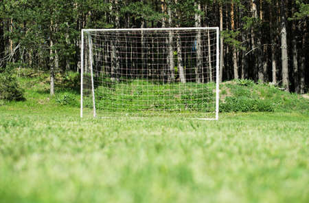 camping pitch: Football gate with net in a forest