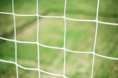 futball: Football net and green grass background