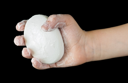 sudsy: Isolated lathered hands and soap Stock Photo