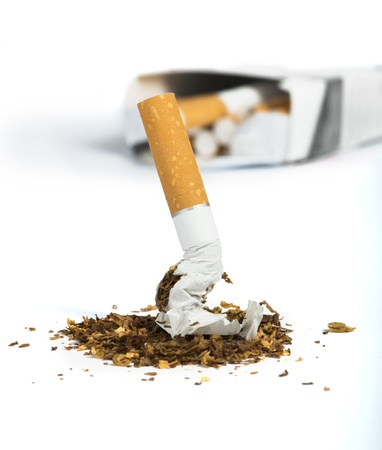 smoking: Crumpled cigarette and tabaco