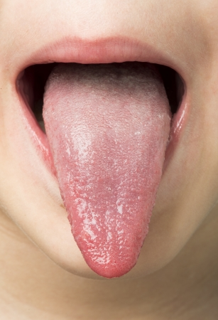 Human tongue protruding out. Child tongue. Stock Photo
