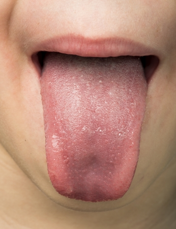 Human tongue protruding out. Child tongue. photo