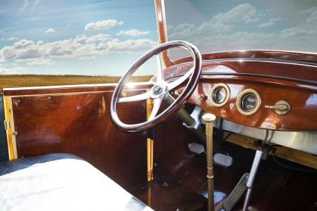 oldtimer: Old vintage retro car interior. Blue sky