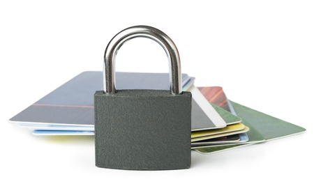 Grey locked padlock and credit cards  Isolated studio shot  photo