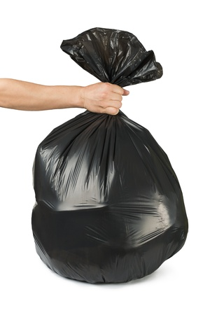 garbage bag: Hand holding black bag of rubbish. White isolated studio shot.