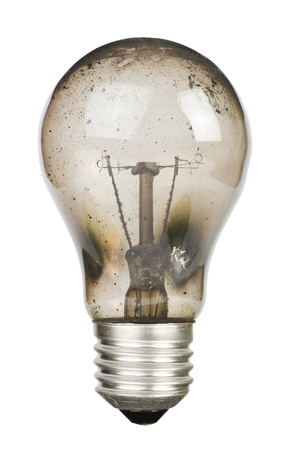 Old burnt lamp smoked inside. White isolated