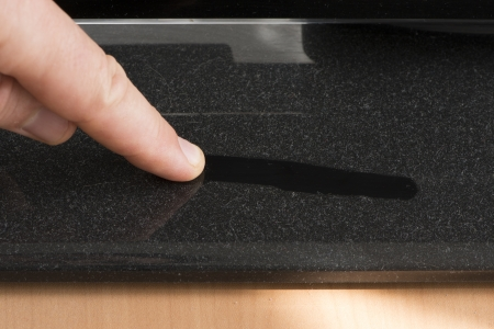 Dust on furniture. Hand and line cleaned dust Standard-Bild