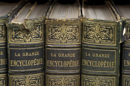 Old books on shelf. French encyclopedia. Close up shot