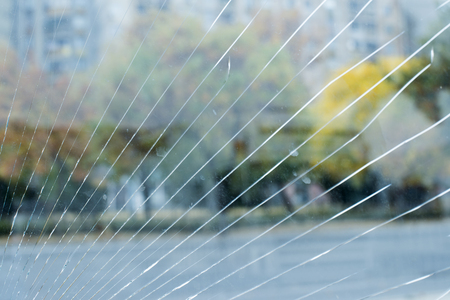 Cracked glass and city  photo