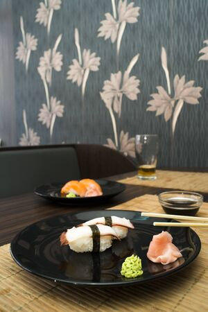 ration: Sushi in sushi bar  Table and ration sushi Stock Photo