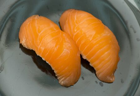 ration: Sushi in sushi bar  Table and ration sushi with salmon