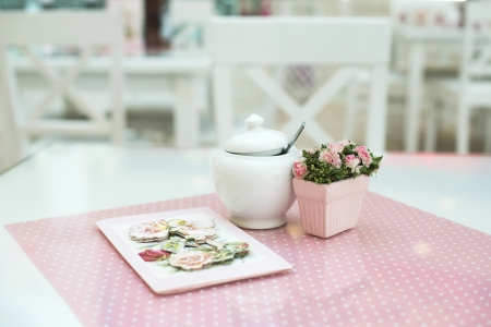 Table in confectionery. Close up pink table photo