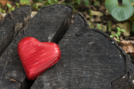 Red wrapped heart on wooden  photo