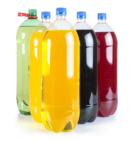 Carbonated drinks in plastic bottles. Multicolored drinks. Studio shot