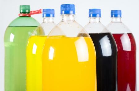 carbonated: Carbonated drinks in plastic bottles. Multicolored drinks. Studio shot