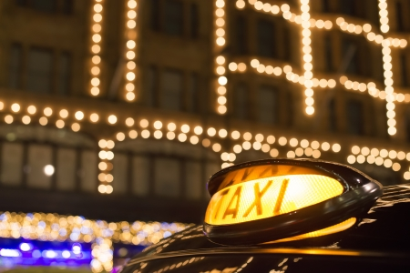 bond street: Taxi in London in front of a shopping center in the night Editorial