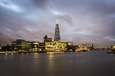 City of London on Thames. Sunset and city lights photo