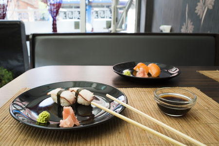 Plate of sushi in restaurant photo